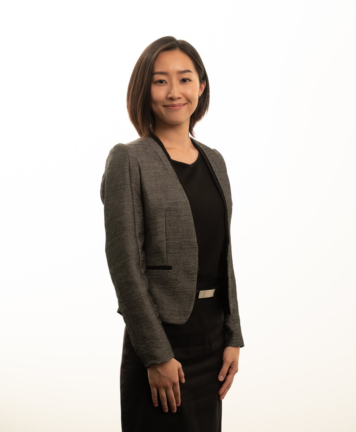 Female posing for corporate headshot with white background