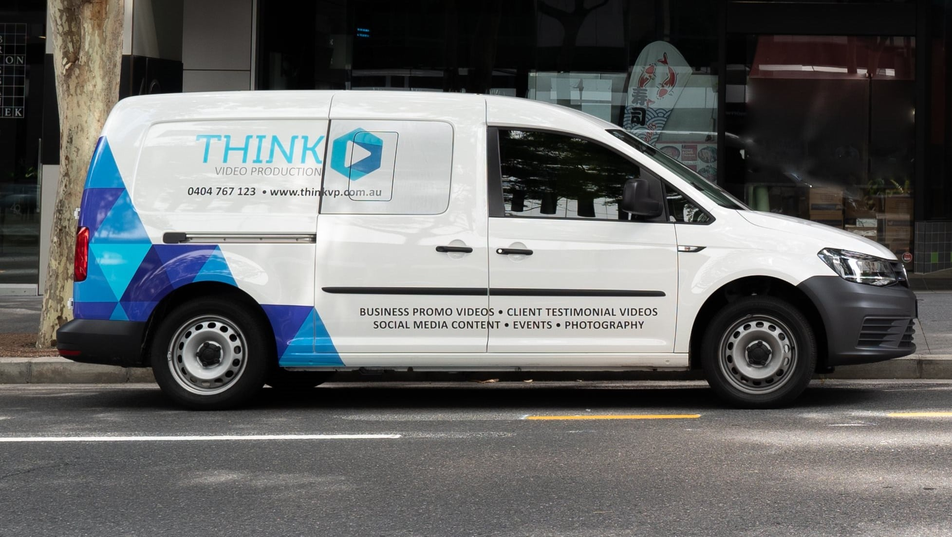 Think Video Production work van parked on street in Brisbane CBD